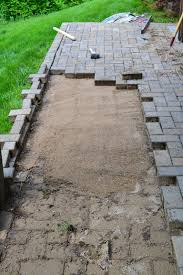 Sand For Patio Pavers by Repairing Sunken Patio Pavers