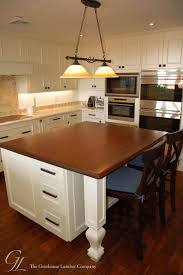 walnut kitchen island countertop designed by artisan kitchen and