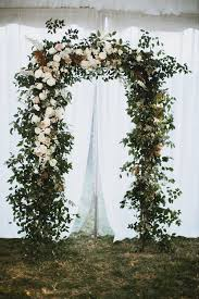 wedding arch nashville lush arch with lots of greenery and white and blush florals
