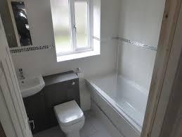 white bath taps steel grey granite white cabinets white cabinets