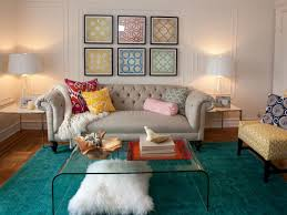 living room with clear glass coffee table and moroccan rug