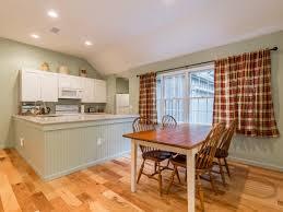 kitchen dinning area simulated wood flooring large window high