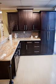 classy white color shaker kitchen cabinets come with black color