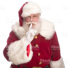 portrait of the real santa claus with fingers on lips stock photo