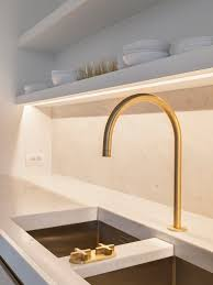 Modern Faucet Kitchen by Obumex Present Day Kitchen Gold Marble Detail Obumex