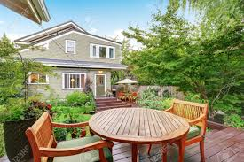back deck of guest house with wooden table set luxury house