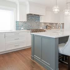 kitchen cabinets with white quartz countertops white kitchen cabinets quartz countertop chevron blue mosaic