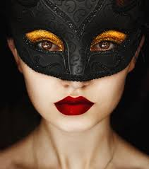 vivid gold eyeshadow under a masquerade mask gorgeous beauty