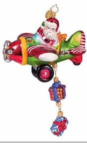 christopher radko santa ornament gifts above airplane ornament