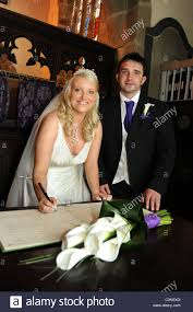 wedding registers a sign the marriage registers during the ceremony at their