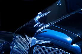 blue classic buick flying ornament photograph by