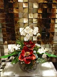 arcadia floral and home decor magnolia orchid floral arrangement designed by arcadia floral