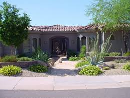 Arizona Landscaping Ideas For Small Backyards A Well Balanced Front Yard Design With Stone Walls And Shrubs