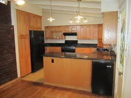 glamorous maple kitchen cabinets with black appliances off white