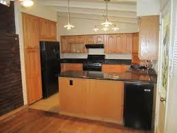contemporary natural maple kitchen cabinets white appliances