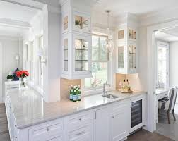 Glass Shelves For Kitchen Cabinets Lighted Glass Front Cabinets With Glass Shelves Transitional