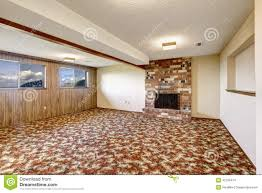 empty living room with brick fireplace and colorful carpet floor
