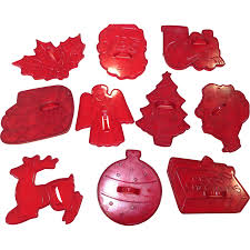 set of 10 vintage red plastic christmas cookie cutters from