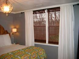 decorating traditional bedroom design with bamboo roman shades