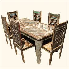 distressed wood table and chairs tucson rainbow reclaimed wood dining table shutter back chair set