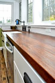 Farmhouse Kitchen Faucet by Countertops A Farmhouse Kitchen With Wood Countertop And