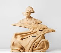 kaptein warps wooden sculptures with glitch effects