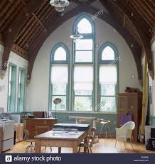 Dining Room Blinds by White Blinds On Tall Gothic Style Windows In A Large Studio Dining