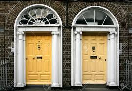 georgian architecture of dublin twin doors in yellow stock photo