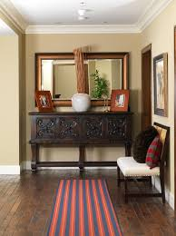 mirror above buffet table dining room transitional with mirrored