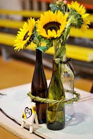 table centerpieces with sunflowers love this might paint the bottles to match our colors but the
