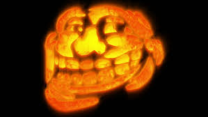 Meme Pumpkin - troll meme pumpkin face with some glowing and fire effects stock