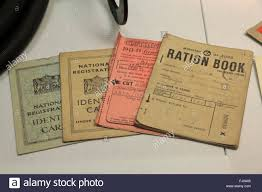 wwii id cards ration books and clothing books on display in the