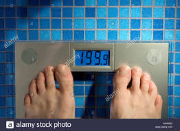 point of view mans feet scale blue glass tile floor in bathroom