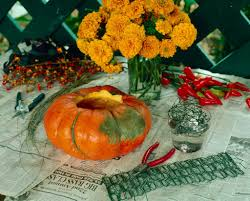 celebrate october with a marigold pumpkin centerpiece