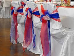 royal blue chair covers white and royal blue organza bows on white chair