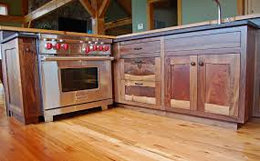custom walnut cabinetry includes live edge staves the flooring is