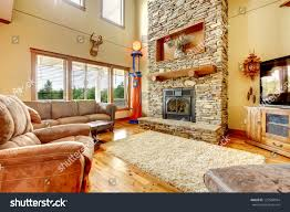 Living Room With High Ceiling by Living Room High Ceiling Stone Fireplace Stock Photo 127568954