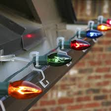 how to hang lights on gutters light