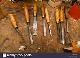old chisels and other woodworking tools in the workshop of telynau