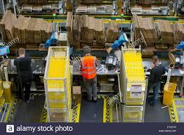 search amazon black friday stock pickers in the amazon fulfillment centre warehouse in