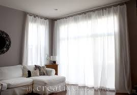 Big Sliding Windows Decorating White Sheer Curtains With White Steel Curtains Rod On Grey Wall Of