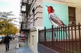 meet the london street artist who painted bird murals all over red faced