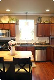 how to decorate the top of my kitchen cabinets fancy how to