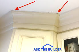 how to install cabinets with uneven ceiling crown molding gap ceiling