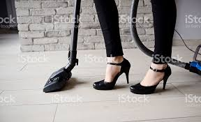 Vaccumming Woman In Heels Vacuuming The Floor Stock Photo 506472516 Istock