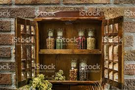 Vintage Wooden Spice Rack Vintage Wooden Spice Rack Or Storage Cabinet And Glass Bottles