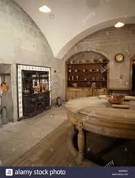large edwardian basement kitchen with vaulted ceiling and circular