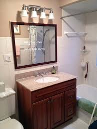 bathroom round white wash basin on black wooden bathroom vanity