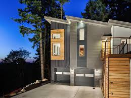 hilltop modern industrial retreat metal siding exterior and