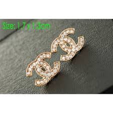 not on the high earrings chanel earings pretty gold color not real but high